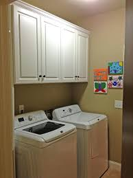 classy laundry cupboard bunnings with wall cabinet bath cabinets melbourne unmuh