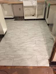 How To Lay Vinyl Tiles In Bathroom How To Lay Luxury Vinyl Tile Flooring Lvt A Feature In Table