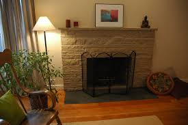 zen style painted stone fireplace makeover with flat black slate inlayed hearth pillows