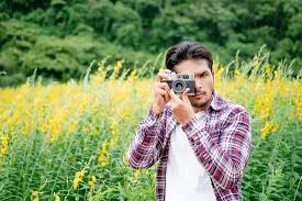 Young <b>hipster</b> man taking <b>photo</b> with <b>retro camera</b>. - <b>Photos</b> by Canva