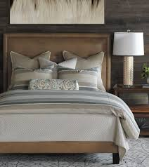 fabulous bedroom with chocolate velvet upholstered platform bed and grey stripe bedding by eastern accents