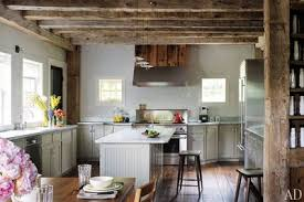 Rustic kitchens designs White Designer Russell Groves Converted 19thcentury Barn That Had Been Moved From Canada To Connecticut Into 15room House The Kitchens Modern Appliances Latraverseeco 29 Rustic Kitchen Ideas Youll Want To Copy Architectural Digest