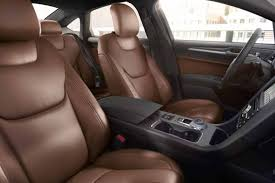 2019 fusion energi titanium interior shown with premium leather trimmed seats in russet