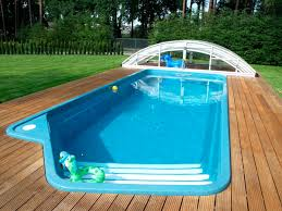 simple inground pool designs. simple outdoor swimming pool design with rectangular shape and wooden deck surrounded by green yard inground designs g