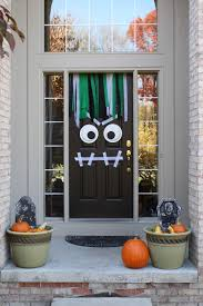 7 Halloween Front Door DIYs That Are Sure to Get Noticed by Trick-or-