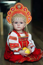 this baby is wearing traditional russian clothing meant for women this baby is wearing traditional russian clothing meant for women to emphasize their inner dignity and emotional restraint today s world