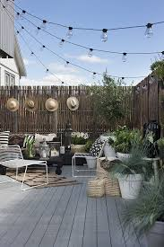 How To Hang String Lights In Backyard Without Trees Magnificent Love The Whole Look Of This Back Garden The Hanging Lights Give A