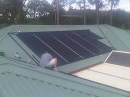 man installing ecolite pool solar heating