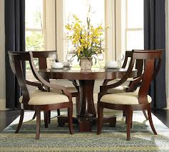 elegant square black mahogany dining table: upholstered dining chairs with brown wood frame and