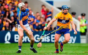 podge collins of clare in action against brendan maher of tipperary during the munster gaa hurling