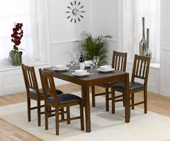 mark harris marbella solid dark oak dining table with 4 chair