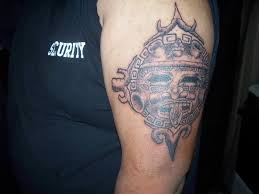 Fantastic Aztec Sun Tattoo On Biceps Tattooshuntcom