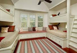 A Bunk Room with a wonderful window seat.