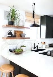 black cabinets white bench marble tap wood shelving super doable floating shelf shelves kitchen