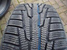 nokian tires. nokia hakkapeliitta tread shown with deep treads and many sipes (thin channels) for better nokian tires