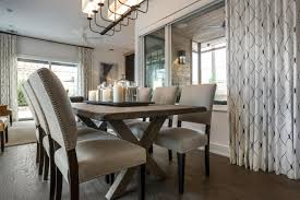 transitional taupe upholstered chair with nailhead trim curtain wooden floor and formal dining room sets