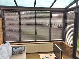 pure wood venetian blinds in conservatory fitted by shuttercraft chelmsford