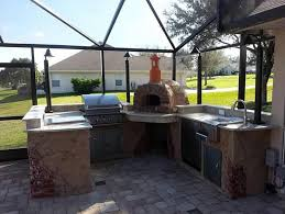 outdoor kitchen with wood pizza oven
