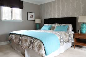 awesome bedroom cream blue bed sheet on the black wooden bed between brown wooden side table with blue and brown bedroom