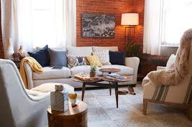an exposed brick wall is the cornerstone behind every industrial living room design
