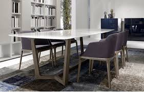 big thin white marble kitchen table design with unique wood leg purple high chairs dining room book shelves wall shelves white painted color purple rug