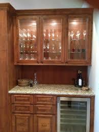 wet bar base and upper cabinet with custom glass doors mediterranean kitchen