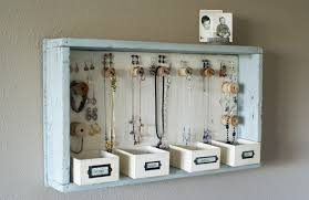Melissa over at A Time for Everything has made one of my favorite DIY  jewelry organizers out there! OK...I don't own any of the materials to make  this, ...