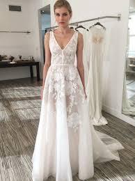 embroidered wedding dress. A Line V Neck Sweep Train Ivory Tulle Wedding Dress with Embroidery