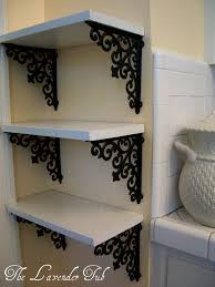 Decorative Wooden Shelf Brackets Put Shelves In The Odd Nook Of A Small Apartment Using Cute