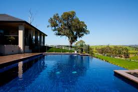backyard infinity pools. Gallery Of Incredible Exotic Infinity Pool Design Inspirations Presenting Deep Blue Water And Brown Ceramic Flor Deck Also Green Grass Landscaping Plus Backyard Pools