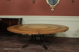 modern expandable round dining table with iron cast leg for modern dining room decor