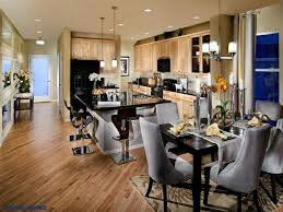 new home lighting ideas. diagonal wood floors sleek bar stools u0026 gleaming black counters strike a contemporary note in this kitchen from the scene by ryland homes near boulder co new home lighting ideas