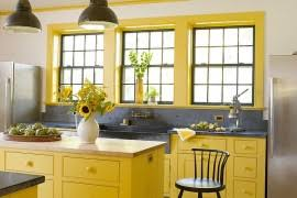 Lovely use of bright yellow in the farmhouse style kitchen ...