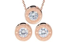 set from michael kors rosegold necklace and earrings