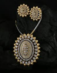 gold finish diamond pendant set styled with pearls beads fancy jewellery loading zoom