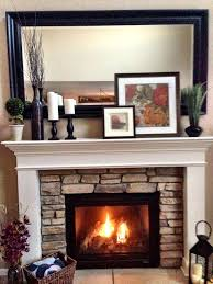 decorations layered in front of mirror above fireplace
