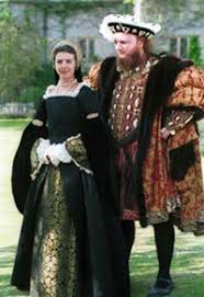 the early tudor costumes of actors playing henry viii and anne boleyn
