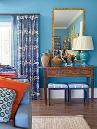 Shades of this hue from light to dark all play together well, whether it's  the painted sky blue walls, ...