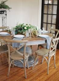 once wed wedding table seating ideas round wedding table soft blue accents rustic wood theme botanical wedding inspiration