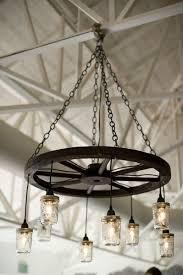 wagon wheel lighting fixtures. Beautiful Wheel Wagon Wheel Chandeliers Are Gorgeous Lighting For A Barn Wedding Or Rustic  Theme EME Photography In Wheel Lighting Fixtures P