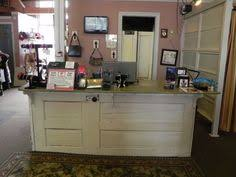 diy island out of date island panelled with old doors countertop removed and replaced with old barn wood diy countertop barn wood and