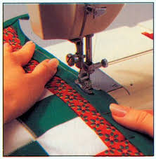 Binding Quilts | HowStuffWorks & ©2007 Publications International, Ltd. Quilt binding can be purchased at  craft stores, or made from matching fabrics. Adamdwight.com