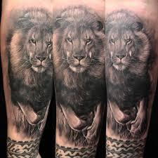 тату со львом мистика и символика