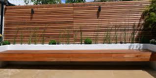 cedar screen raised planter bed limestone paving hardwood screened