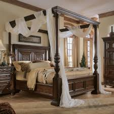 Black Wooden Canopy Bed Frame Queen on the Brown Wooden Floor of As ...