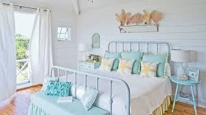 beachy bedroom furniture. beachy bedroom featuring wroughtiron painted bed breezy curtains and shell display above furniture o