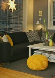 living rooms with black furniture. interesting living gray walls and black couch with yellow accent pieces on living rooms with black furniture