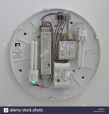 electric light fitting the cover removed showing the wiring electric light fitting the cover removed showing the wiring circuit bulbs capacitors batteries and correct connections and electrical symbols