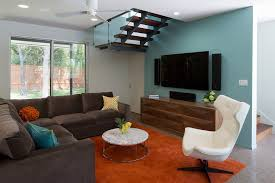 austin orange area rug with tufted sectional sofas living room contemporary and white ceiling fan egg