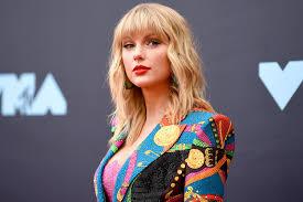 Taylor swift's metal album cover for folklore, photo via twitter/@colstot. Taylor Swift Debunks Woodvale Album Rumors Report Door